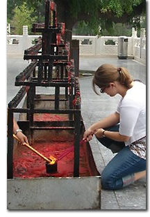 Christina lighting incense in Tianjin, China, photo